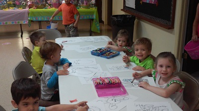 Kids busy with crafts.