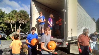 Some items still must be unloaded by hand. Lots of hands.