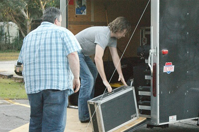 Christian based music group unloading their own equipment at Newberry UMC